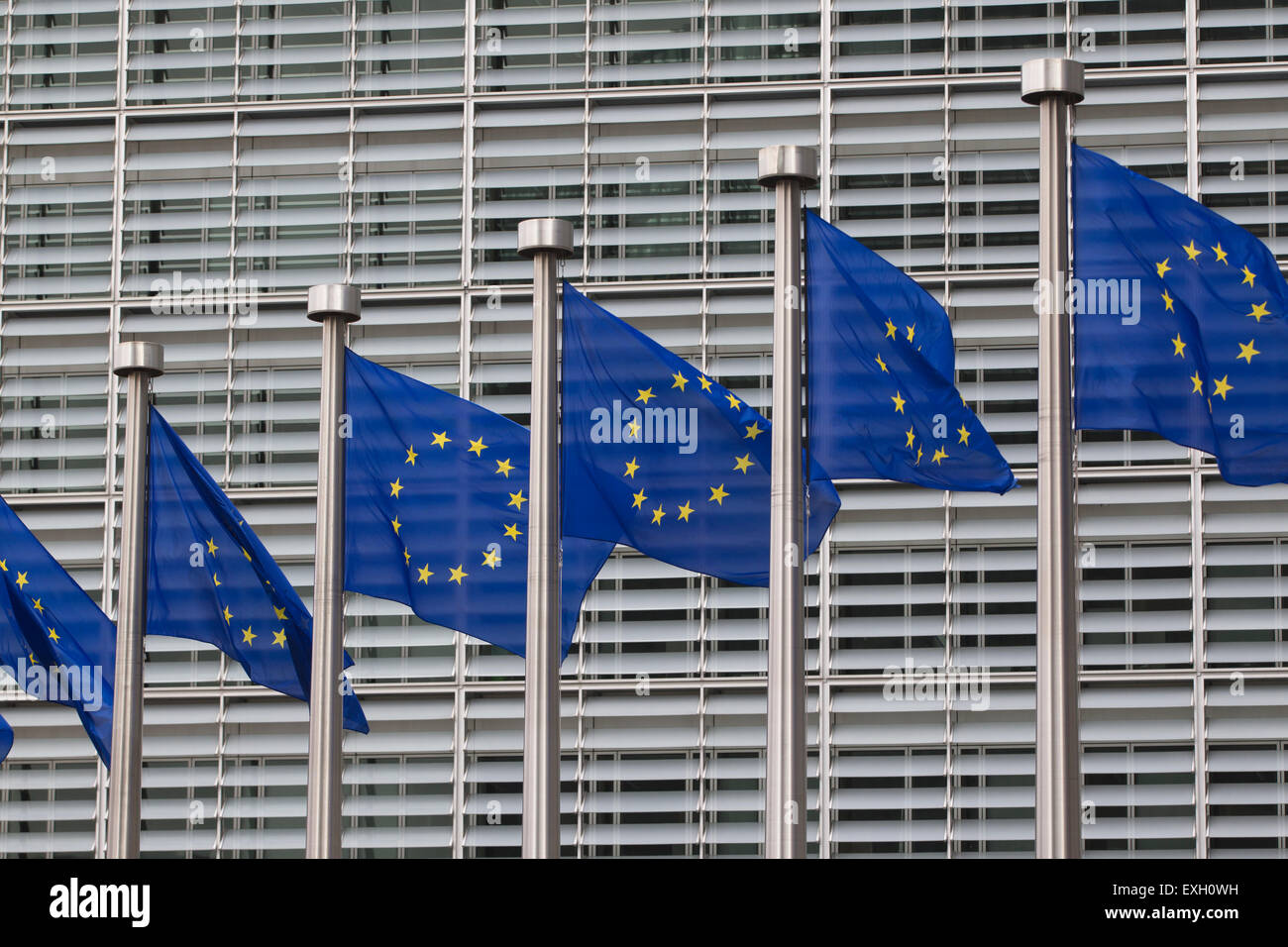 European flags in front of the Berlaymont building, headquarters of the European commission in Brussels, Belgium - Stock Image
