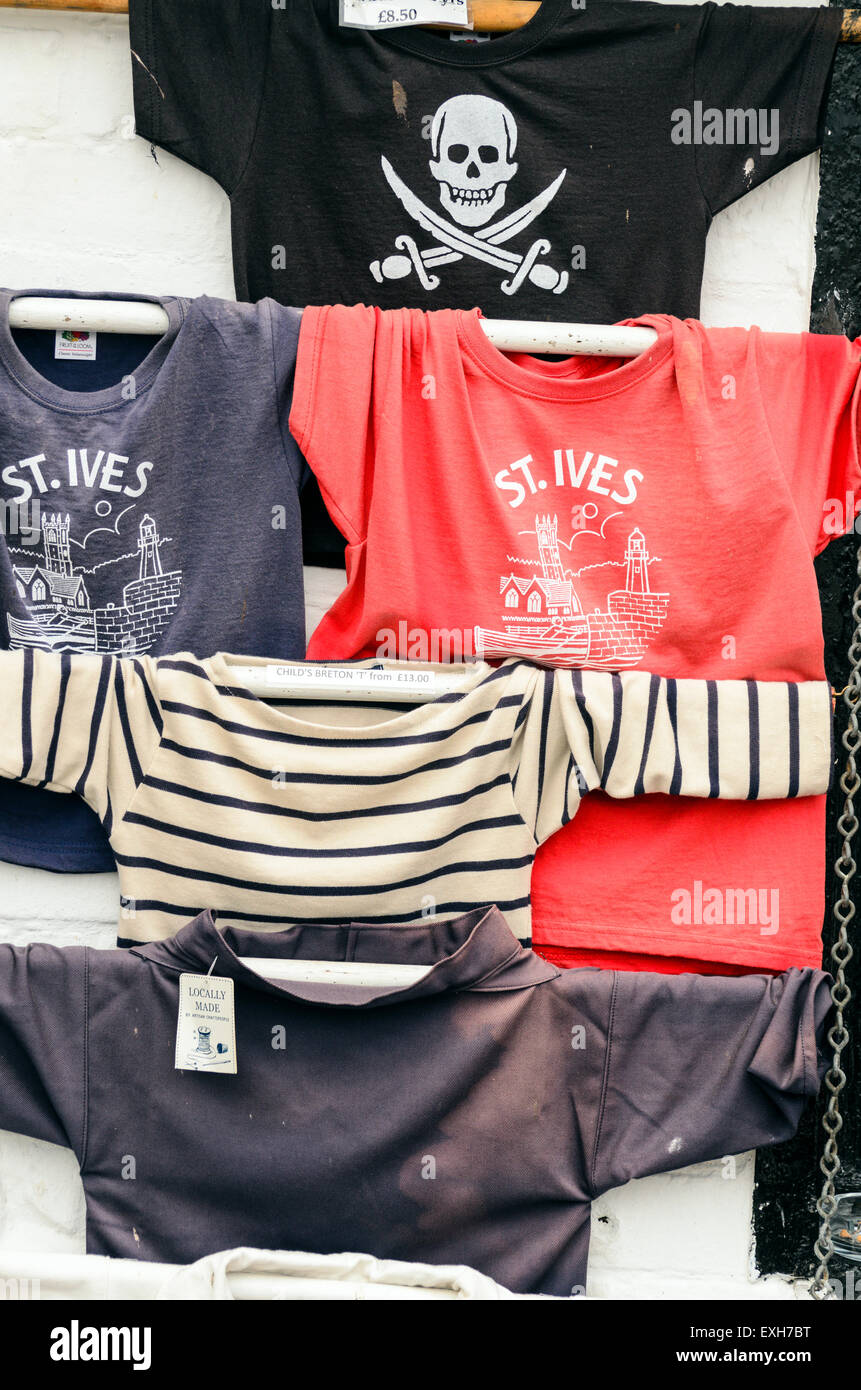 T Shirts on display outside a shop in St Ives, Cornwall, England, U.K. - Stock Image