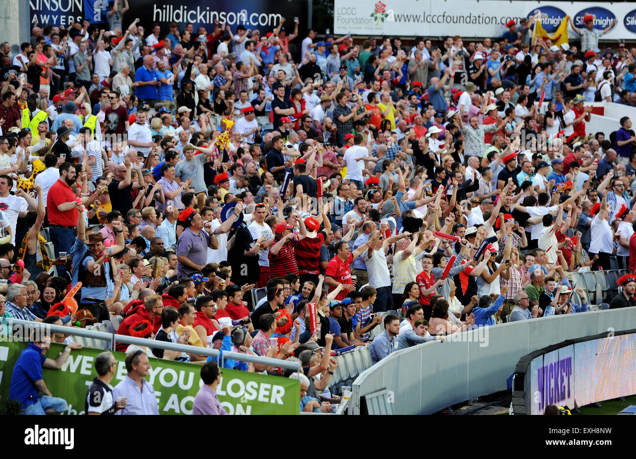 Fans celebrating in the crowd at Emirates Old Trafford, Manchester, England. T20 Blast cricket match Lancashire - Stock Image