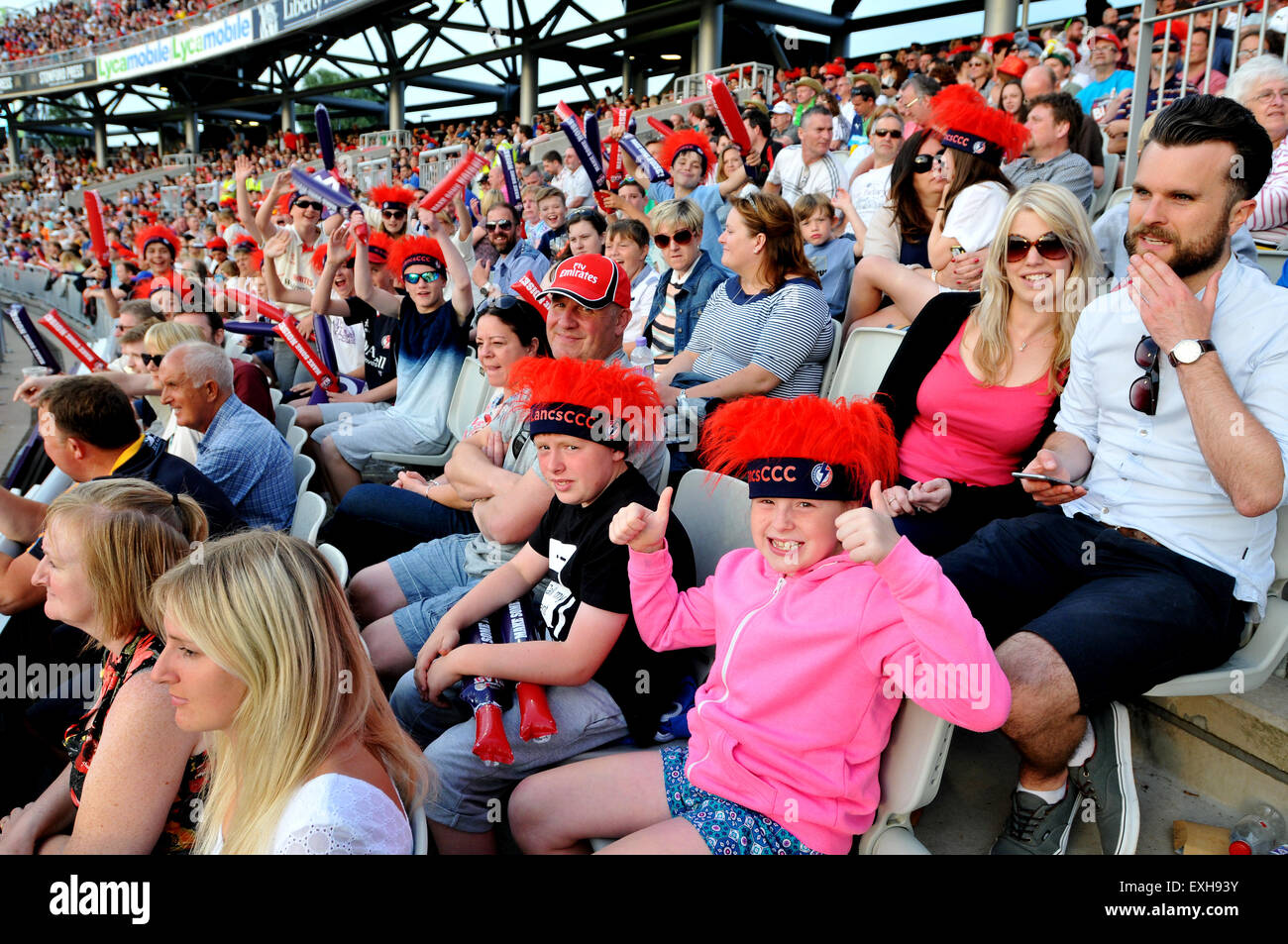 Fans celebrating in the crowd at Emirates Old Trafford, Manchester, England. T20 Blast cricket match Lancashire Stock Photo