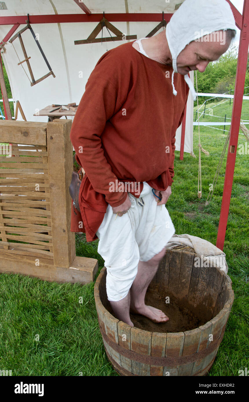 Demonstration of Medieval house building techniques -treading the daub - Stock Image