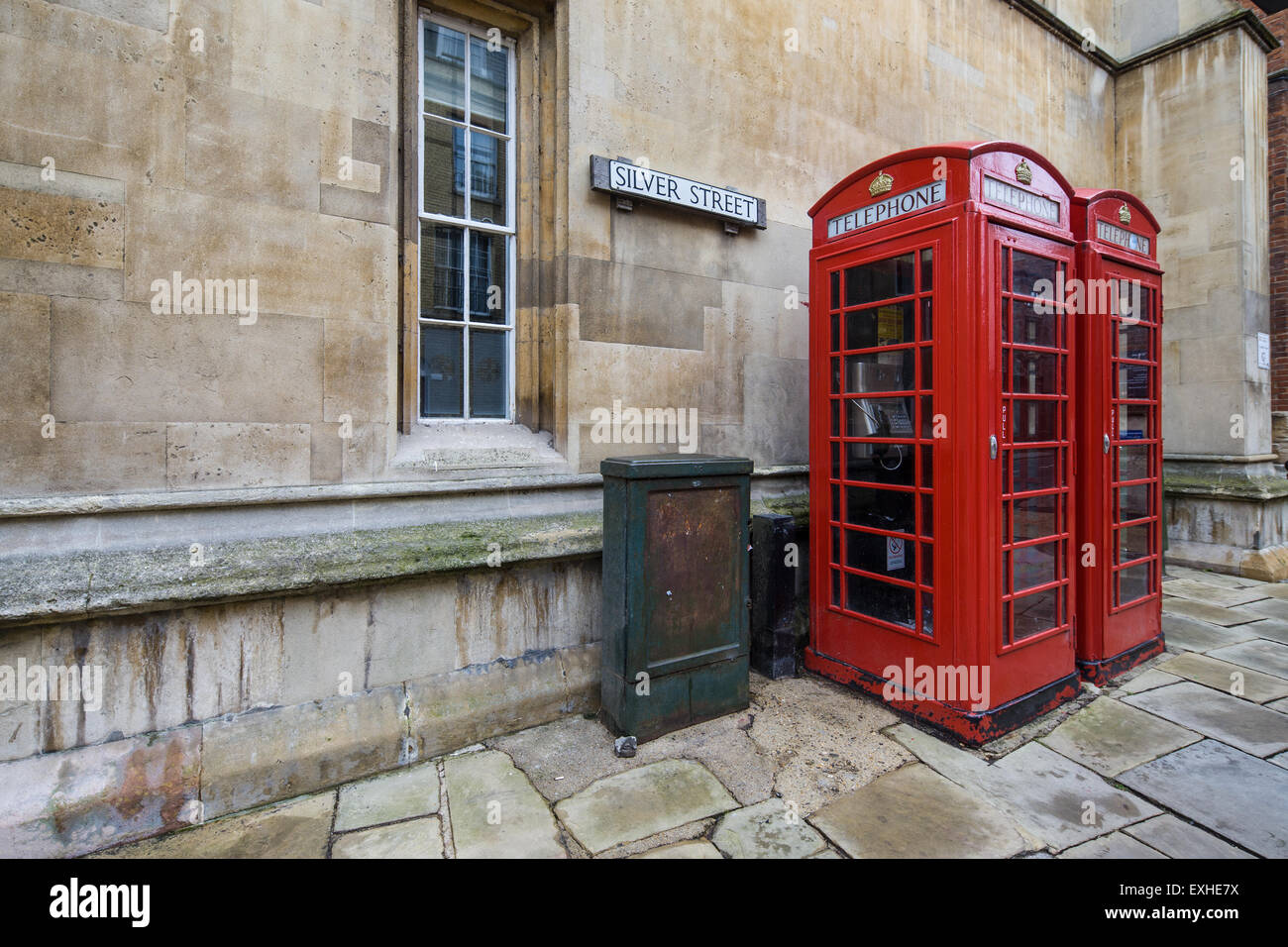Two red telephone boxes in a street in England - Stock Image