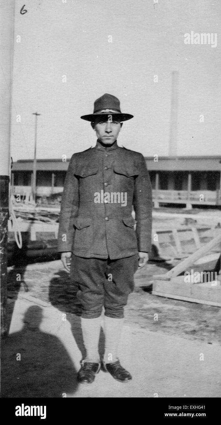 Man in uniform next to flagpole, Denver 1 - Stock Image