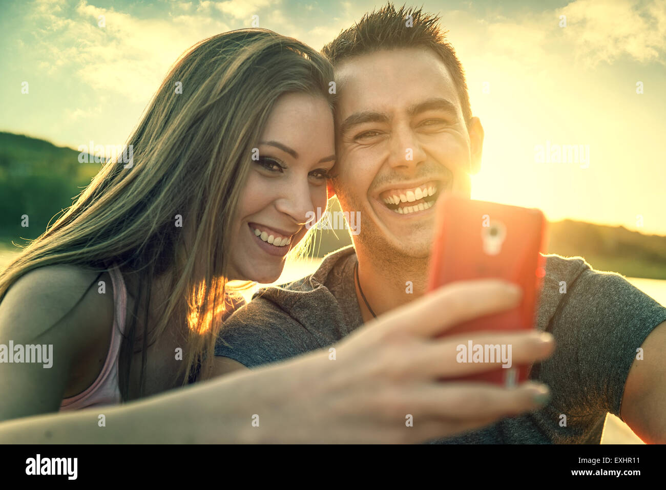 Love Couple smiling, close-up photo selfie - Stock Image