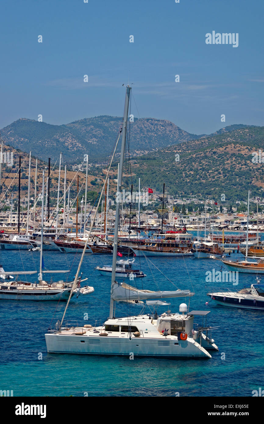 Catamaran and Yacht anchorages, East Bay at Bodrum town, Muğla Province, Turkey - Stock Image