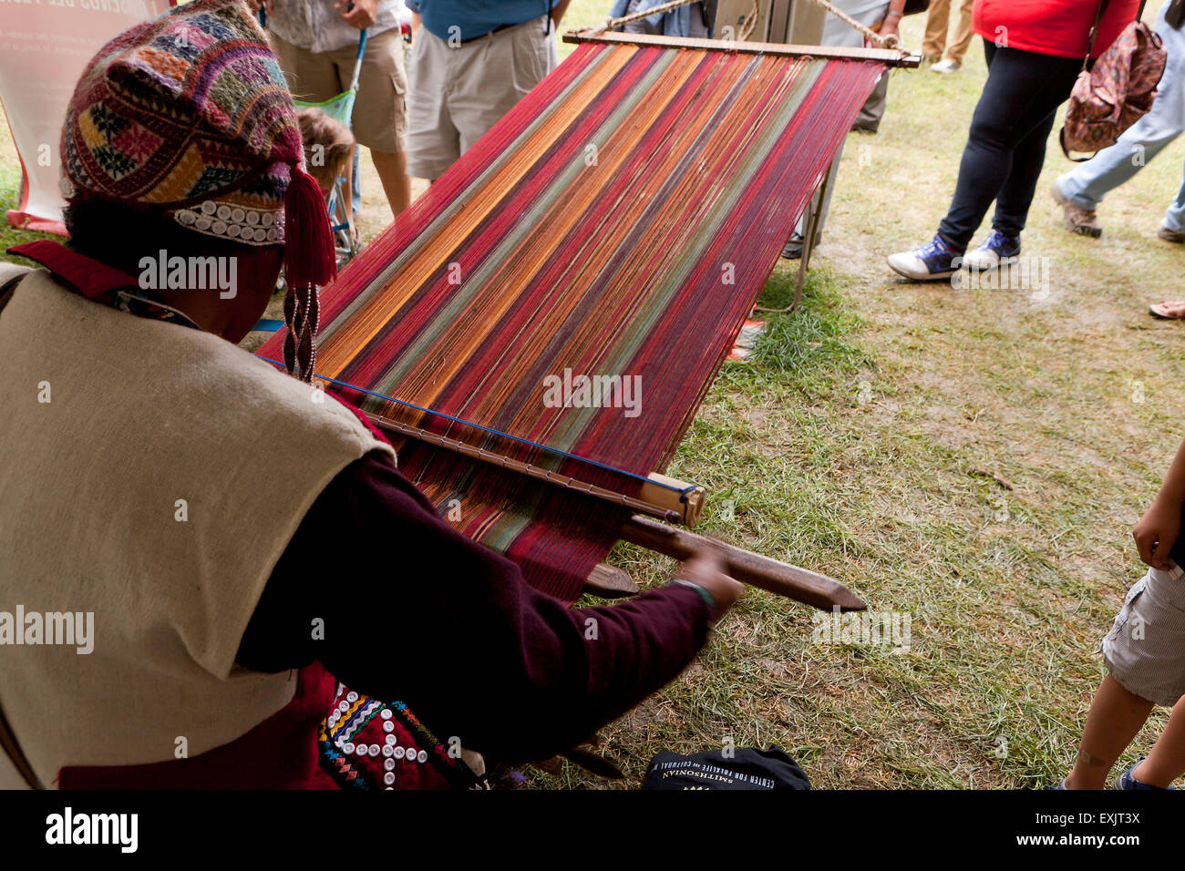 Peruvian man from Chinchero weaving traditional fabric using backstrap loom Stock Photo