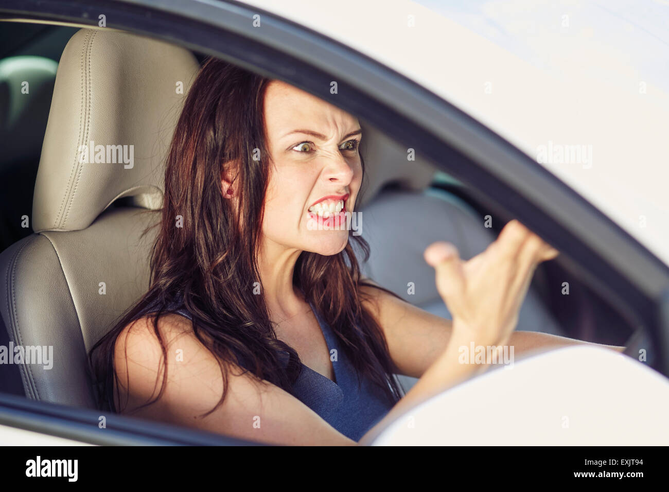 Woman shouting at another driver - Stock Image