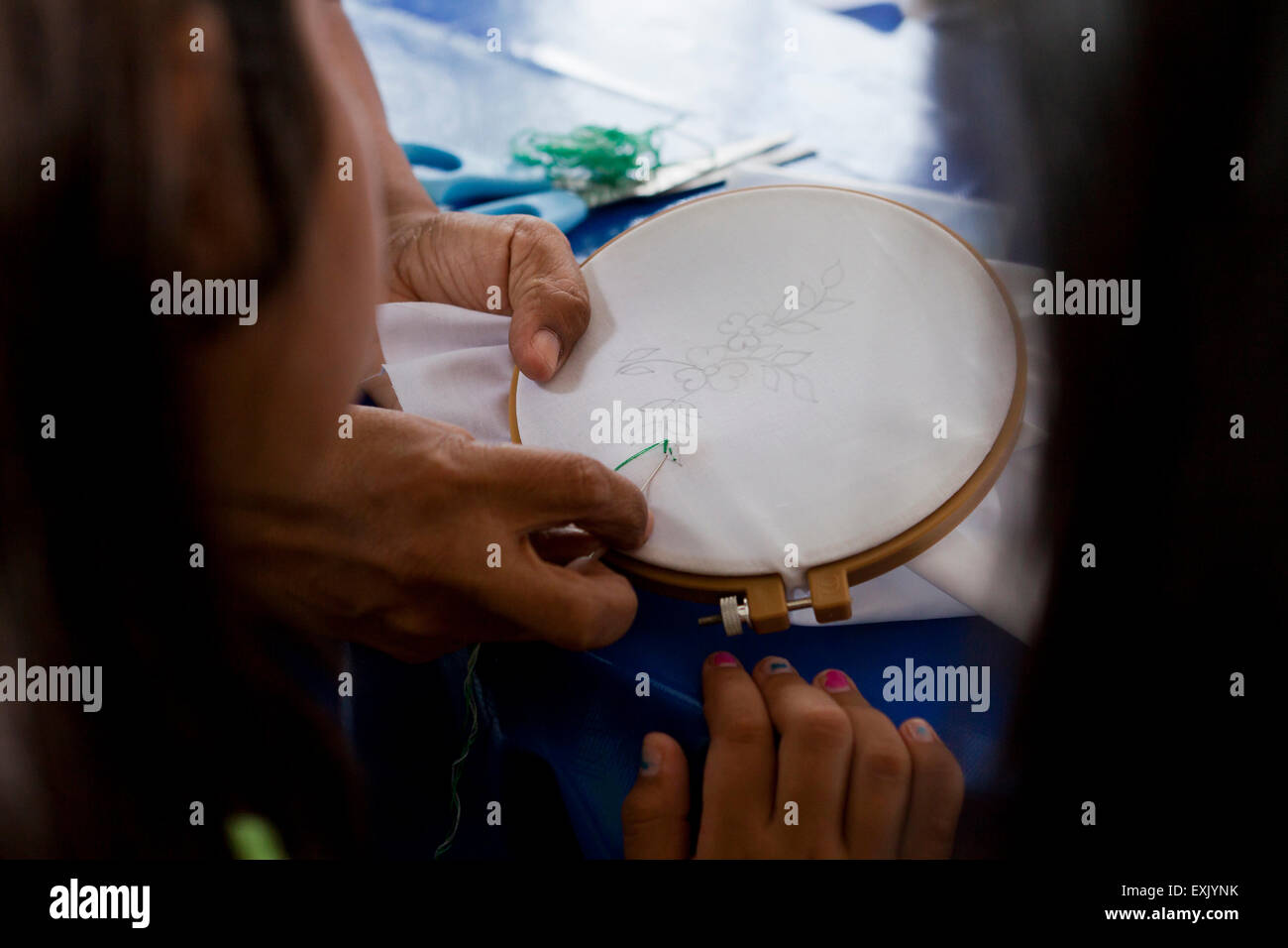 Woman using embroidery hoop - Stock Image