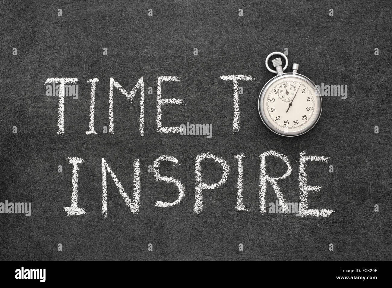 time to inspire concept handwritten on chalkboard with vintage precise stopwatch used instead of O - Stock Image