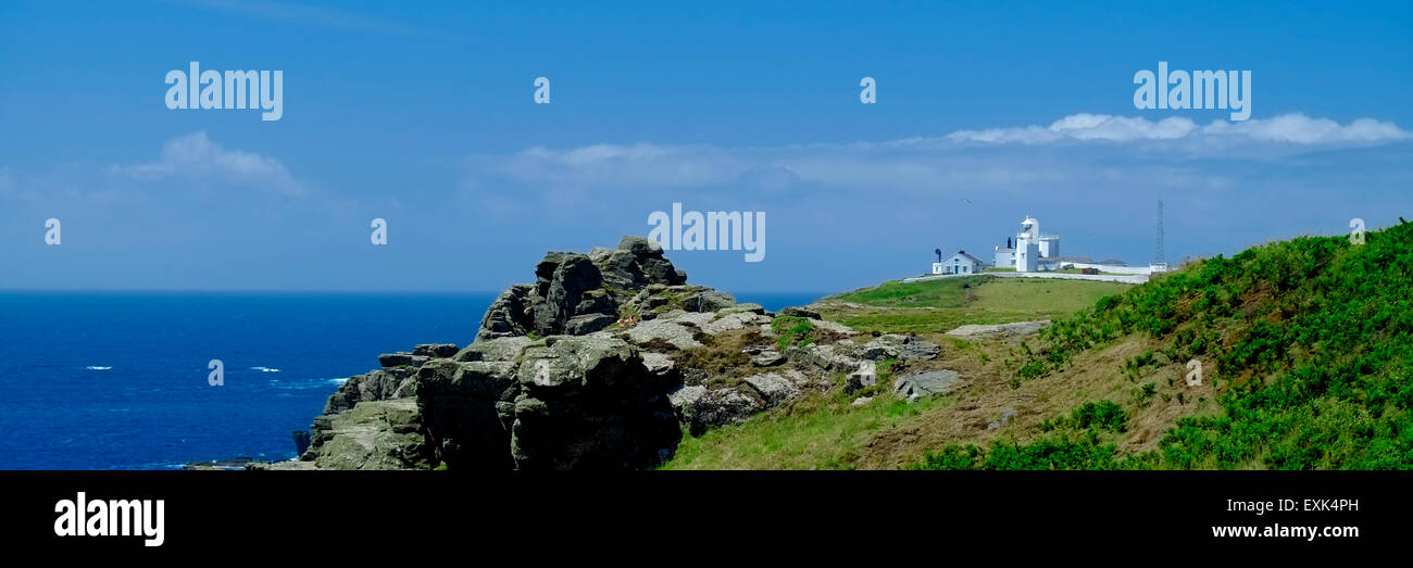 Lizard Lighthouse on cliff top at Lizard Point, Cornwall, UK, from the South West Coastal Path - Stock Image