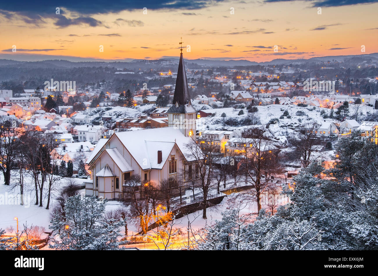 First snow of the year in Grimstad. Photo taken from Binabben look-out point during sunset. - Stock Image