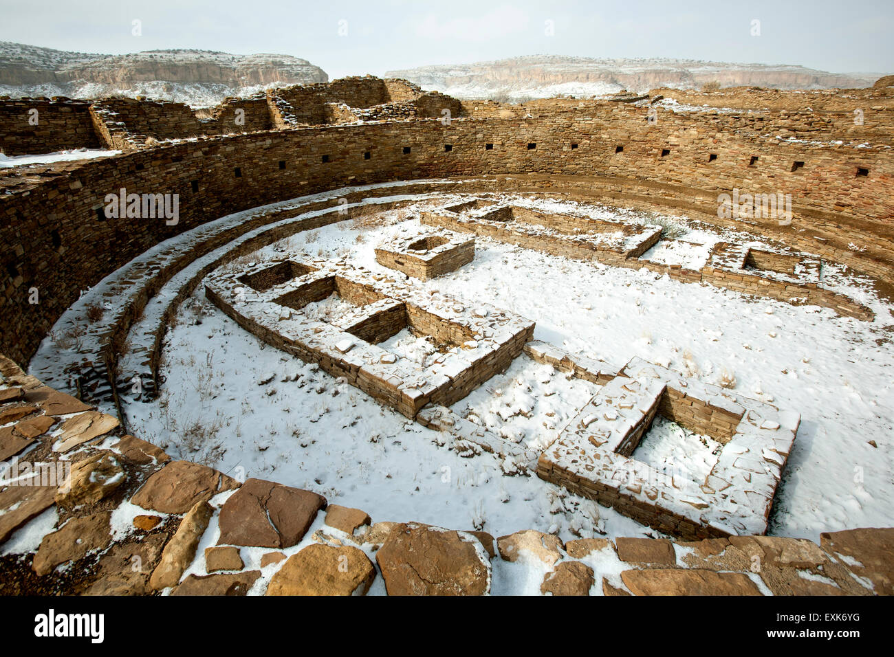 Kiva (ceremonial chamber) under snow, Pueblo Bonito great house, Chaco Culture National Historical Park, New Mexico - Stock Image
