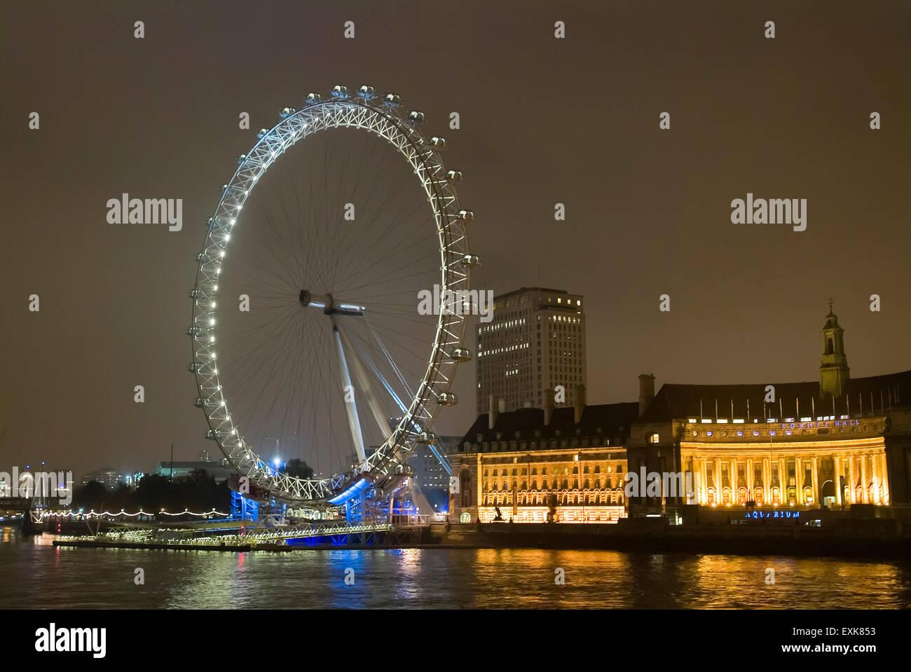 London eye and river themes at night London England UK Europe - Stock Image
