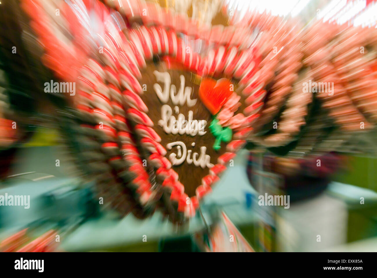 """""""Ich liebe dich"""" means I love you on a gingerbread heart on a christmas market, zoomed and blurred, in Germany Europe Stock Photo"""
