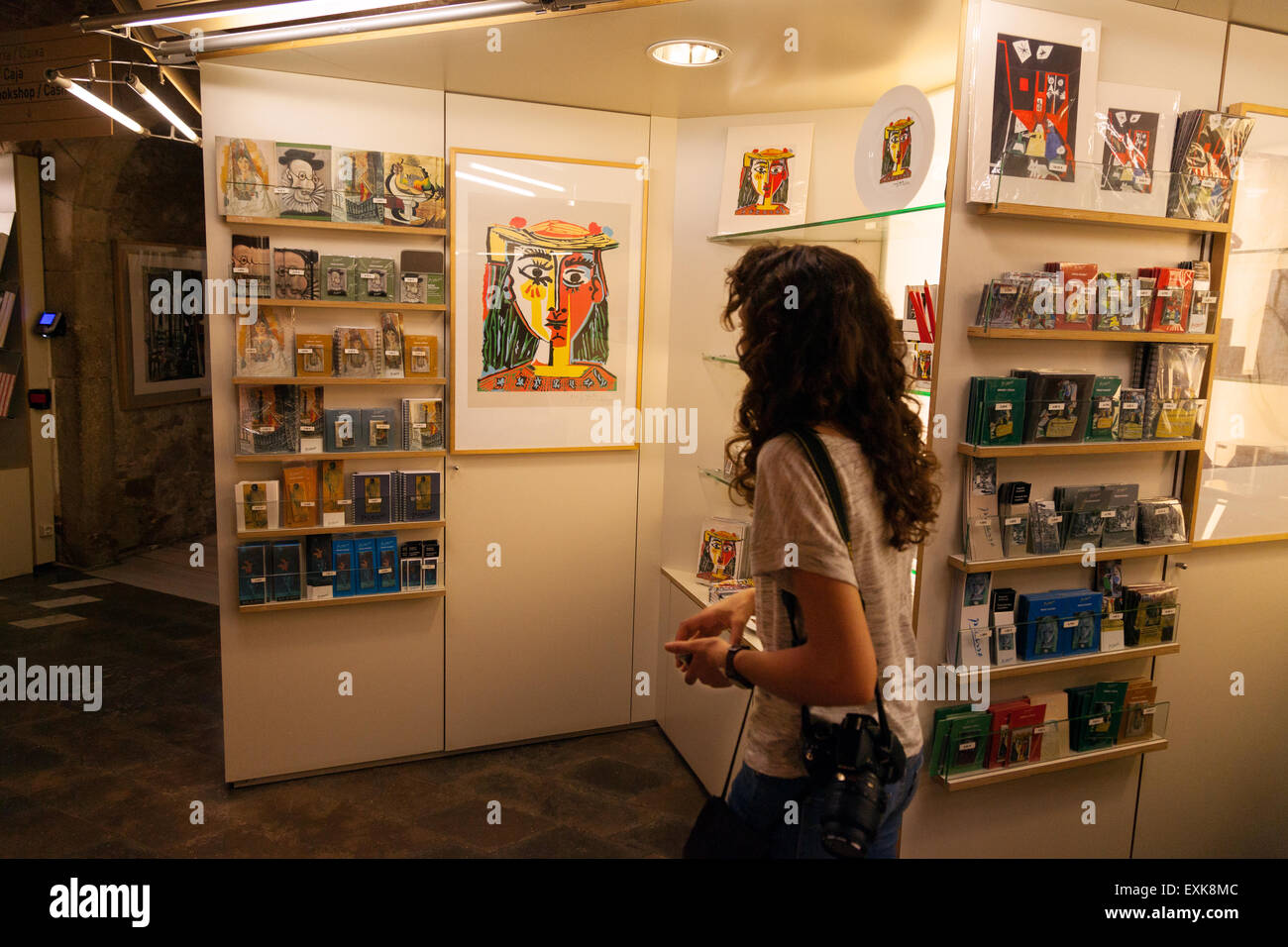 A tourist in the gift shop of the Museu Picasso ( Picasso Museum ), Barcelona, Spain Europe - Stock Image