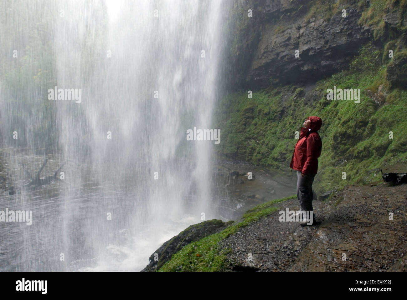 Waterfall Henrhyd Falls in Soutwales England Europe with longtime exposure, woman is looking Stock Photo