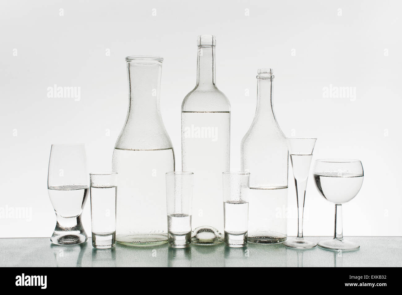 Glassware with clean water on the light background - Stock Image