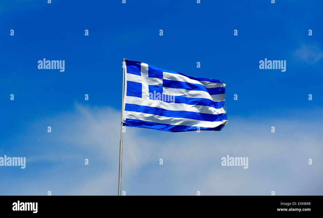The flag of Greece against a blue sky. - Stock Image