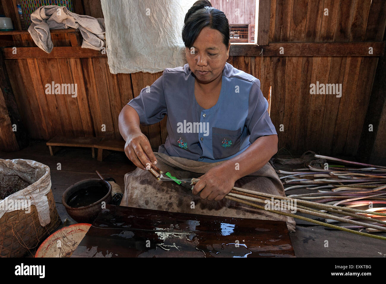Manufacture of silk threads from the stems of lotus plants, lotus weaving, Paw Khone, Inle lake, Shan State, Myanmar - Stock Image