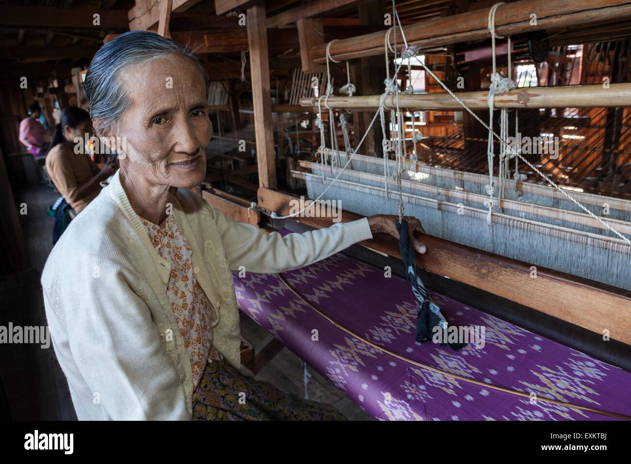 Old local woman weaving fabric from lotus flower silk, lotus weaving, Paw Khone, Inle lake, Shan State, Myanmar - Stock Image