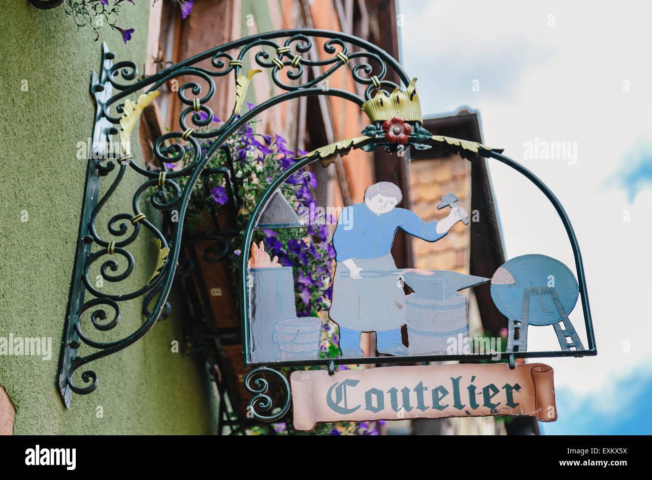 Coutelier shop sign, Rue du General de Gaulle, Riquewihr, Alsace, France Stock Photo