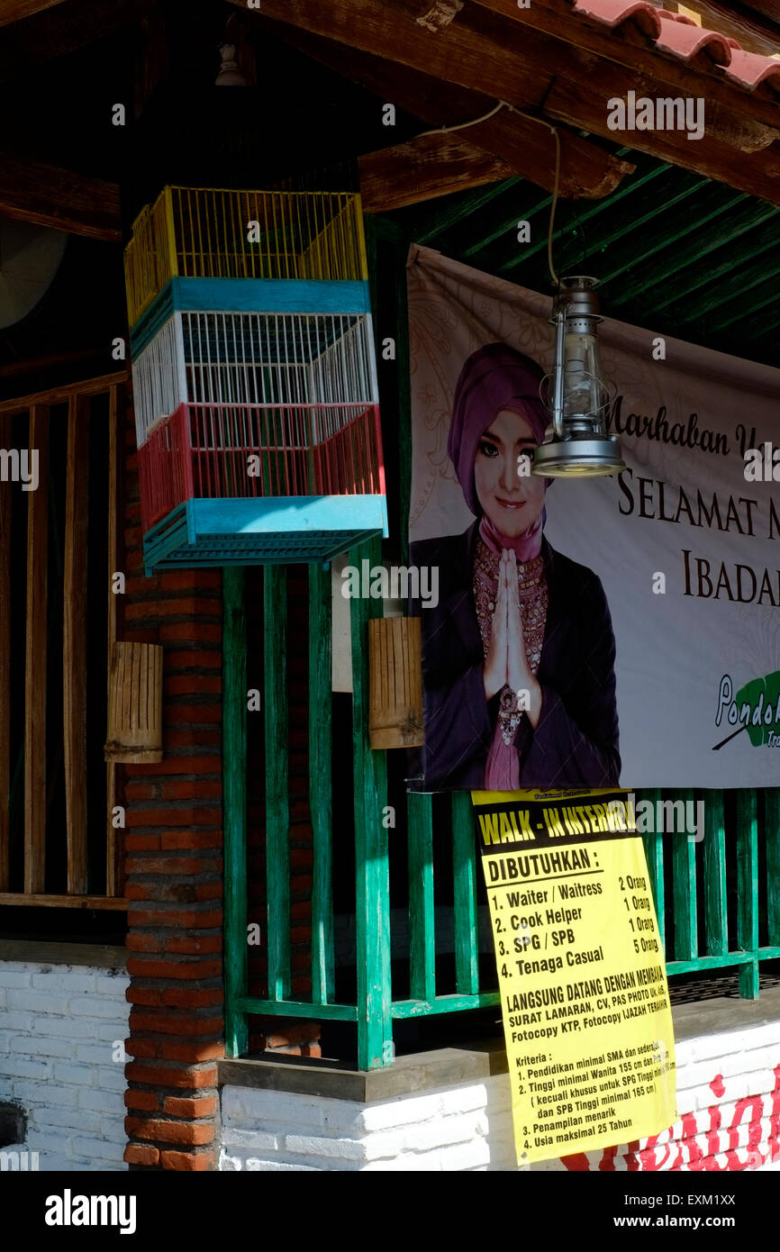 entrance to a restaurant with large sign advertising staff vacancies in malang java indonesia - Stock Image