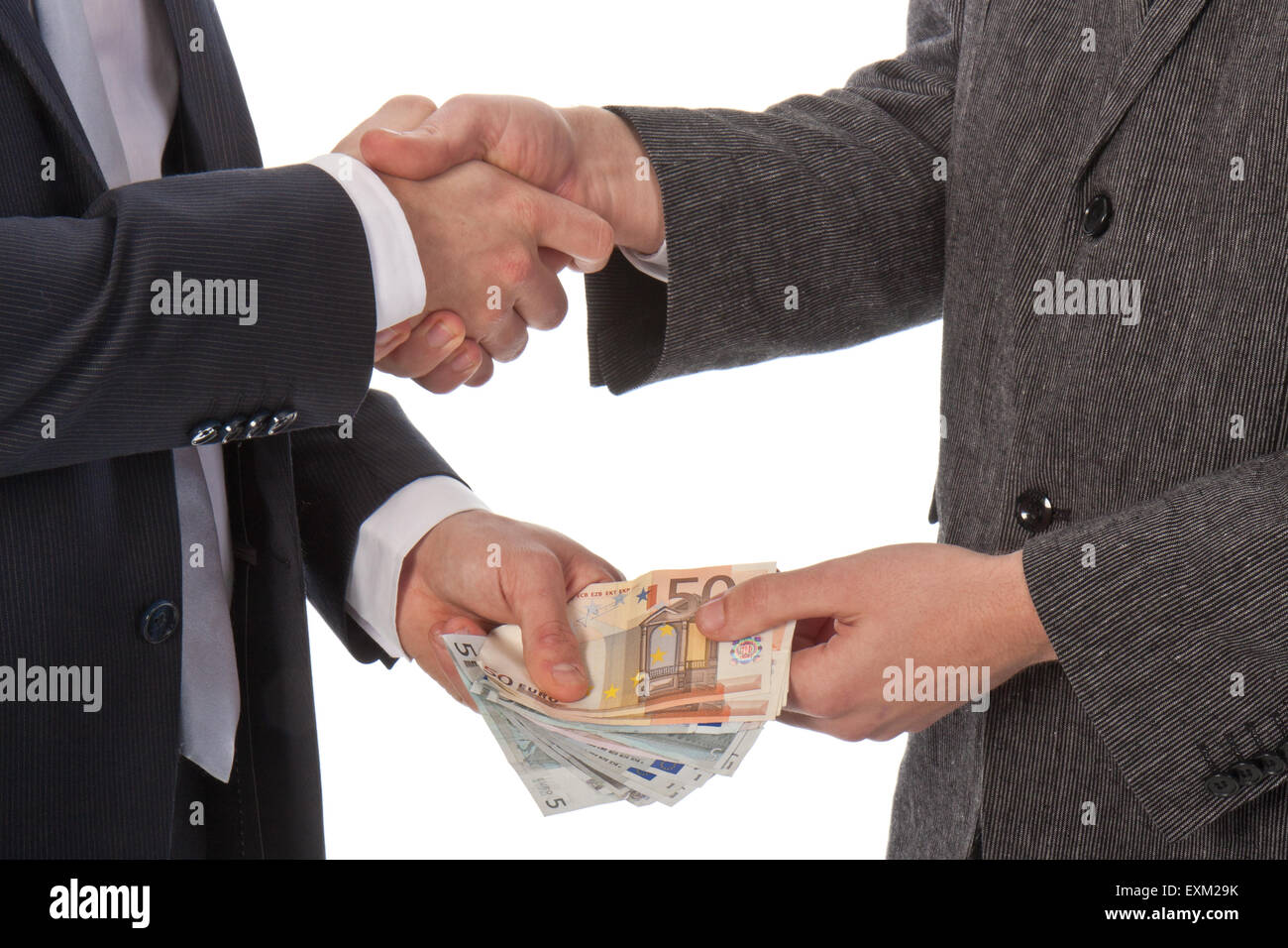 Two businessmen and paying money; isolated on white - Stock Image
