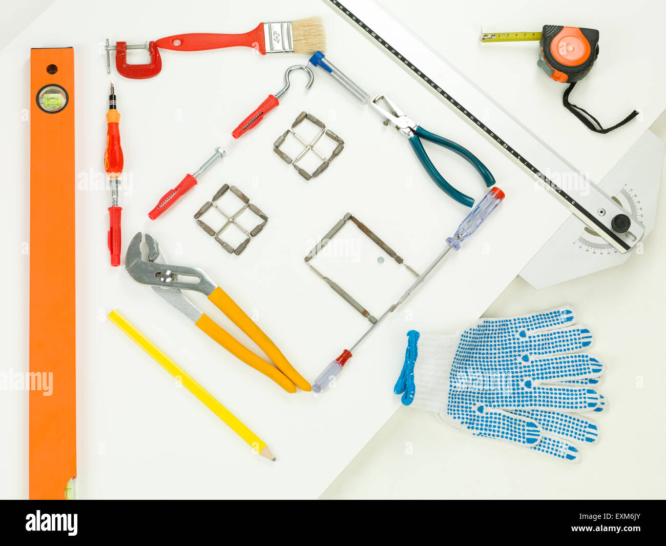 shape of house made with household and construction tools, on white background. perspective view - Stock Image