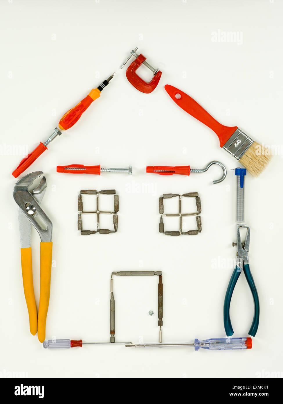 outline of house made with household and construction tools, on white background. top view - Stock Image