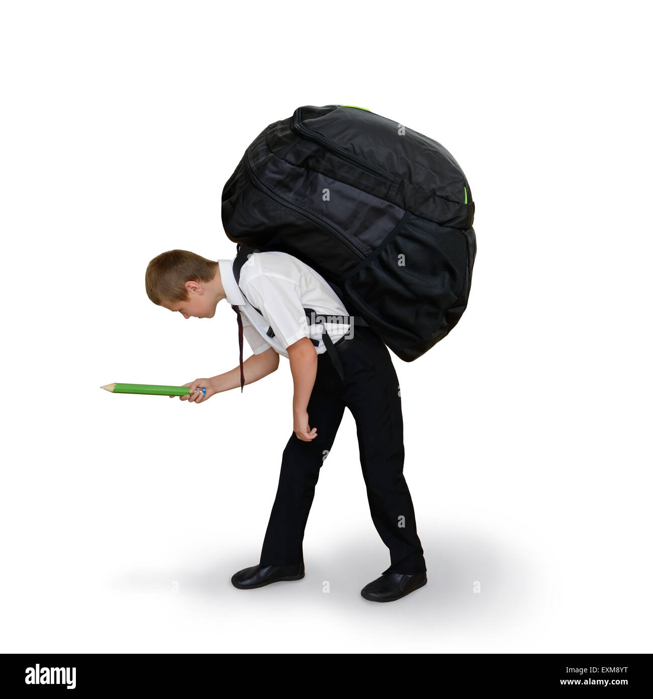 schoolboy carries a large backpack - Stock Image
