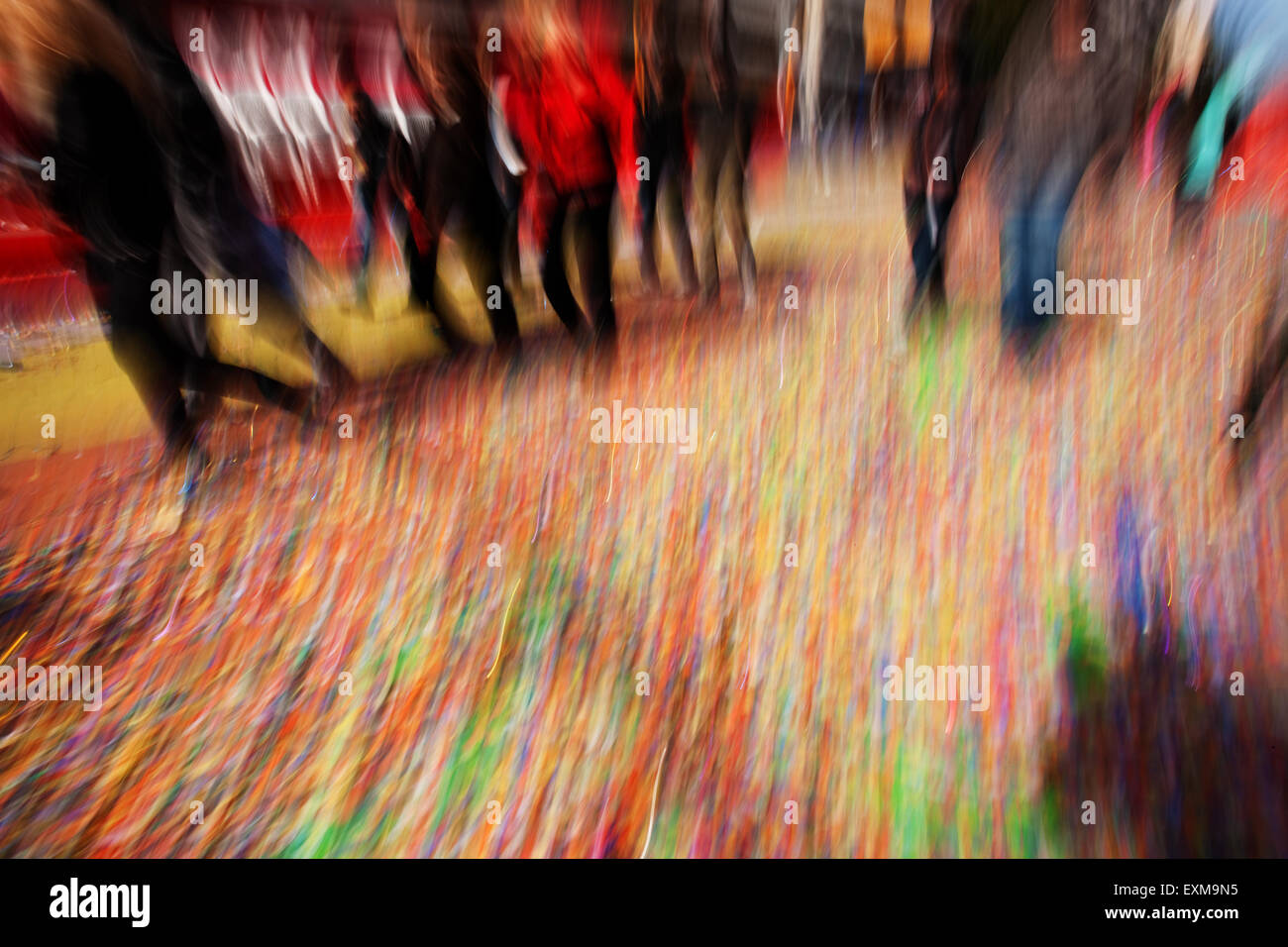 Colourful motion swirl transfering the vibes from the Agios Ioannis Rentis annual carnival  in Athens, Greece - Stock Image