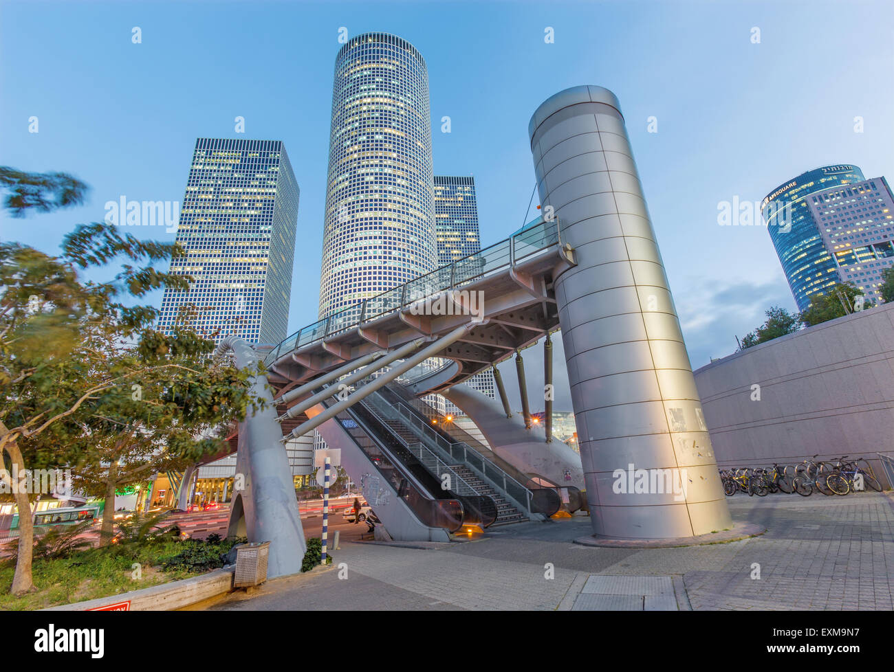 TEL AVIV, ISRAEL - MARCH 2, 2015: The skyscrapers of Azrieli Center in evening dusk by Moore Yaski Sivan Architects - Stock Image