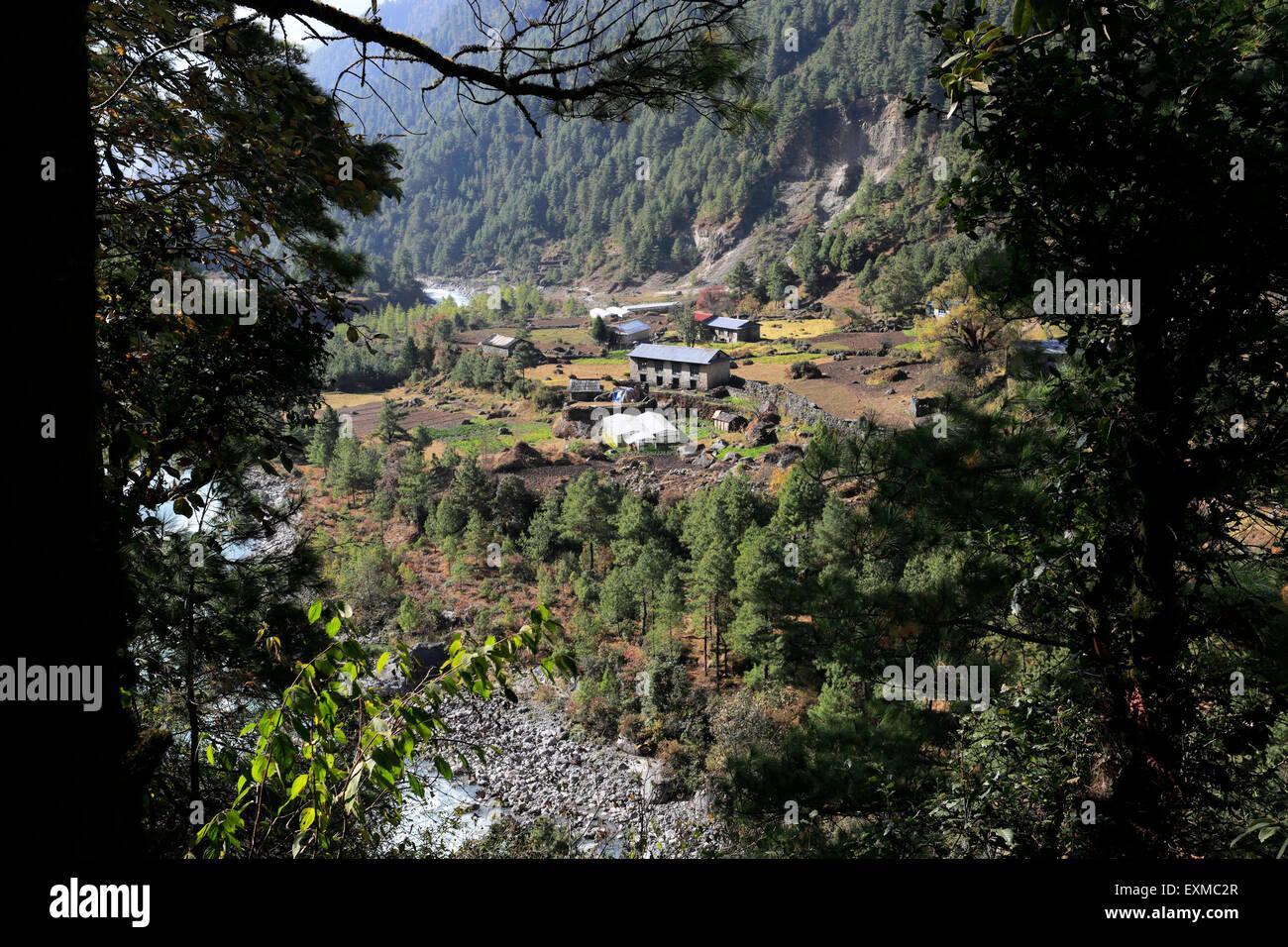 View over Ghat village on the Everest base camp trek, Sagarmatha National Park, Solukhumbu district, Khumbu region - Stock Image