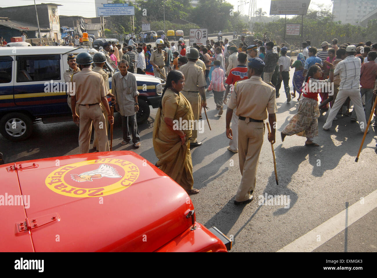 Riot police try to control the situation after the Dalit community resort to violent protests ; Bombay Mumbai - Stock Image
