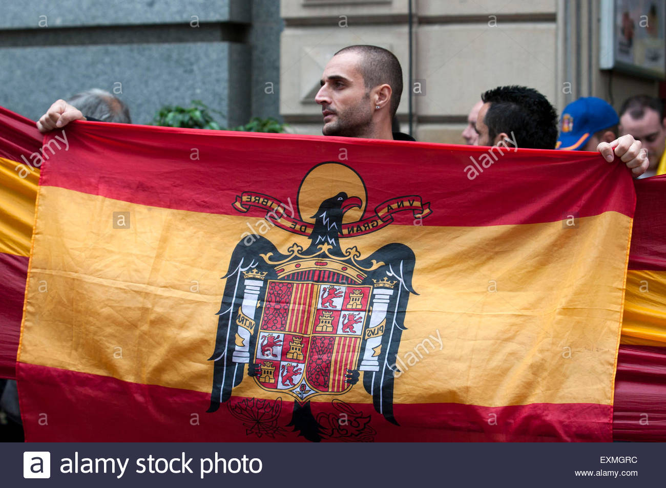 Barcelona, Spain. 12th Oct, 2014. Demonstrators doing the fascist salute during the Spanish Ultra Nationalism speech. - Stock Image