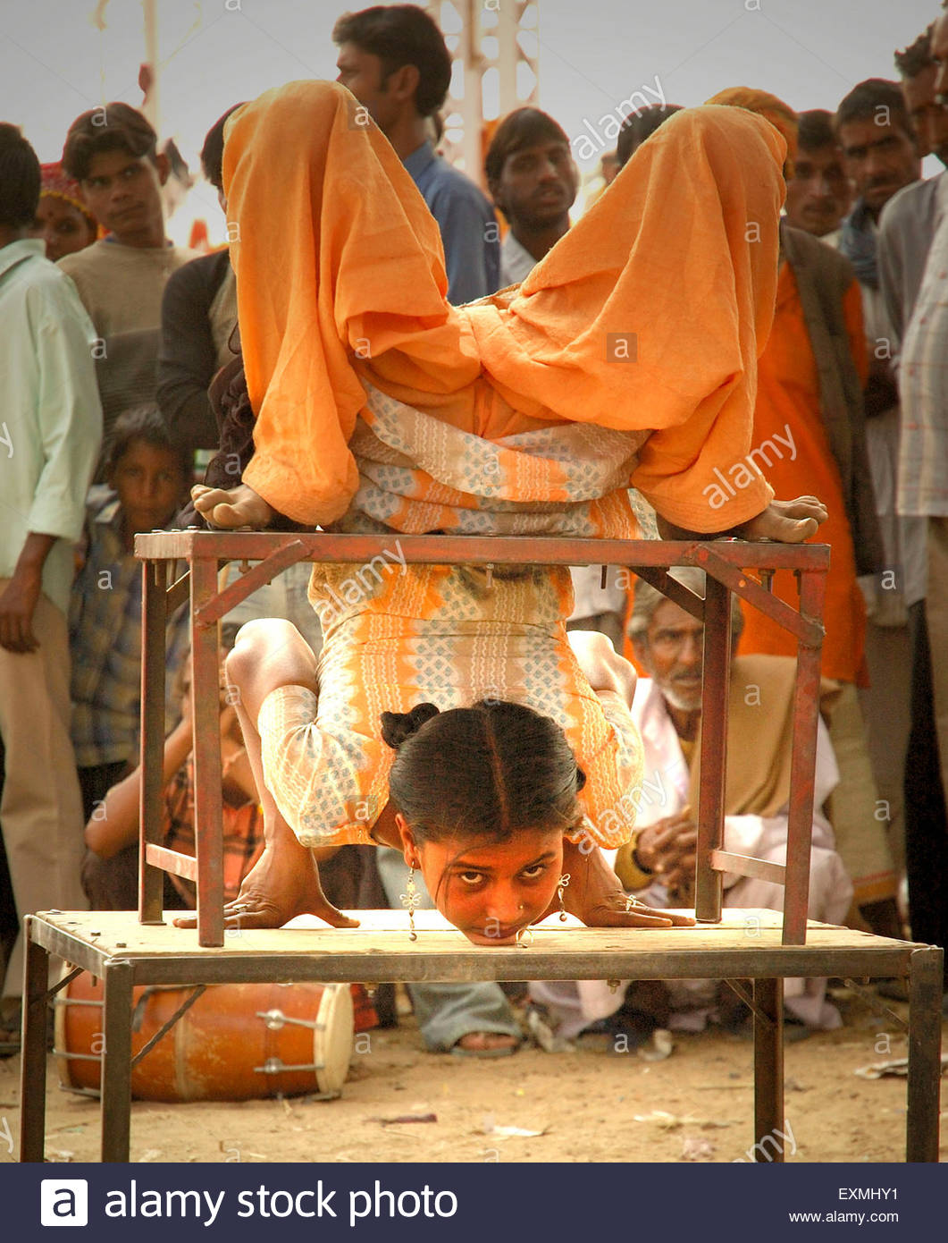Bending over backwards to earn a living ; India - Stock Image