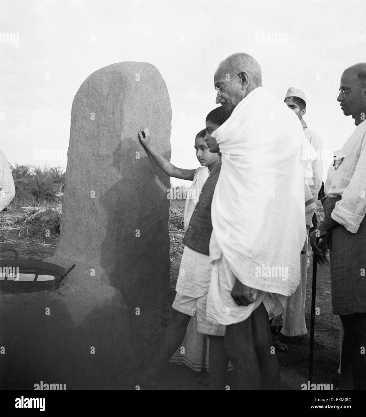 Mahatma Gandhi accompanied by Abha Gandhi and others visiting the village Segaon near Sevagram Ashram ; 1944 NO - Stock Image