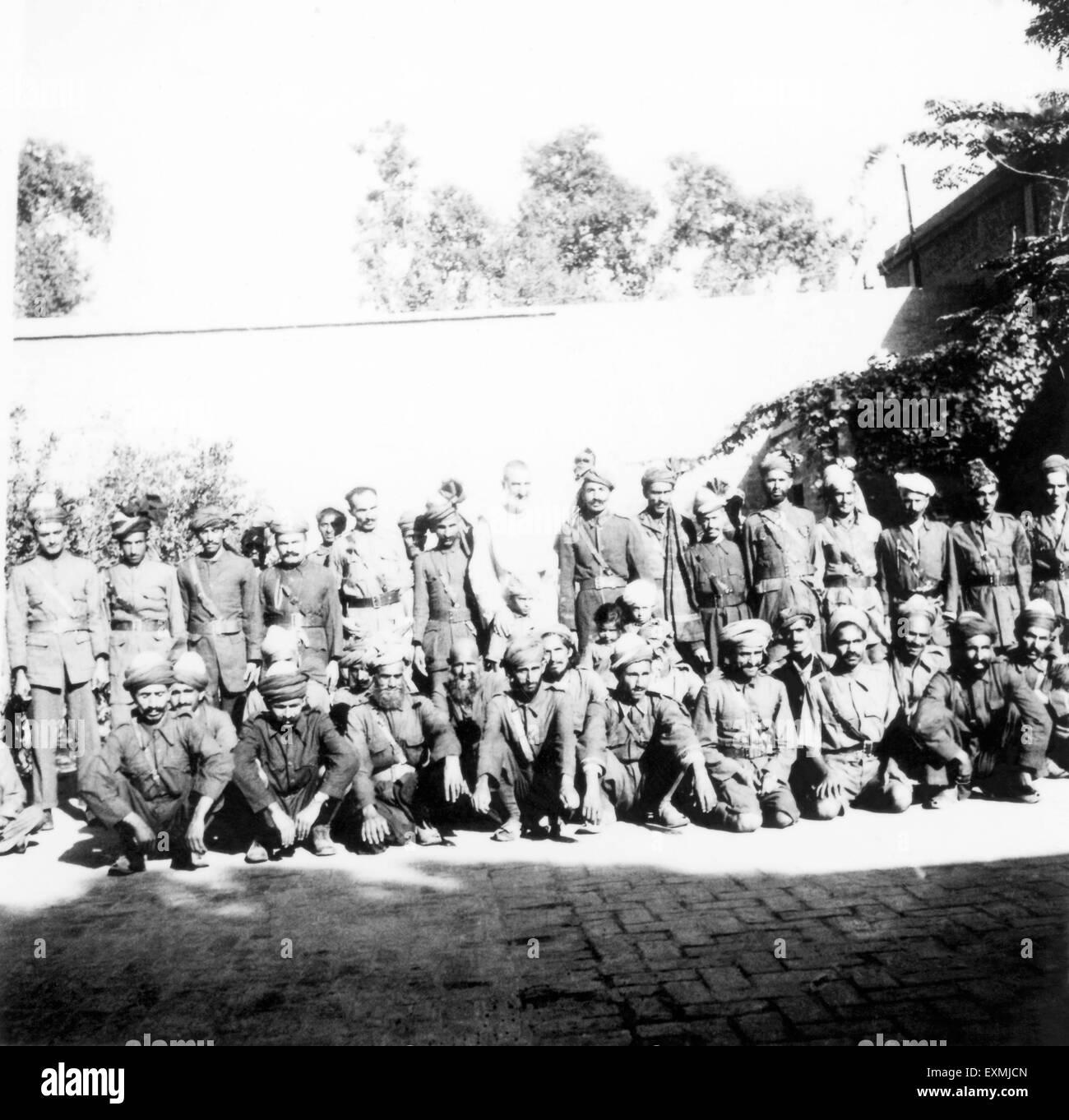 Khan Abdul Gaffar Khan midst nonviolent army founded occasion of Mahatma Gandhi visit Peshawar North West Frontier - Stock Image