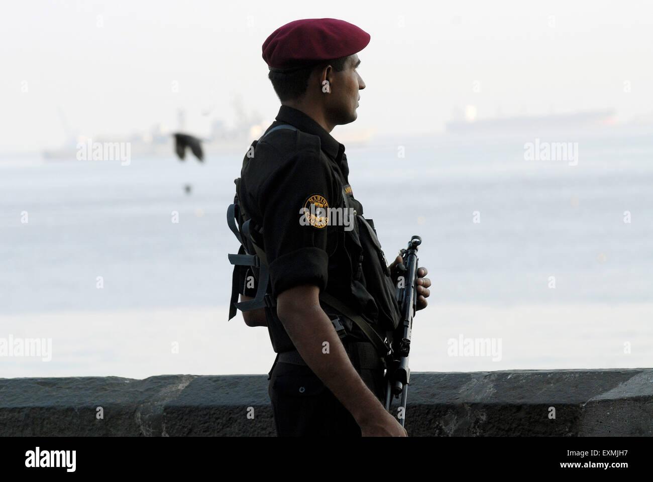 Indian Navy commando take guard as naval musical band perform beating retreat at Gateway of India Mumbai Maharashtra - Stock Image