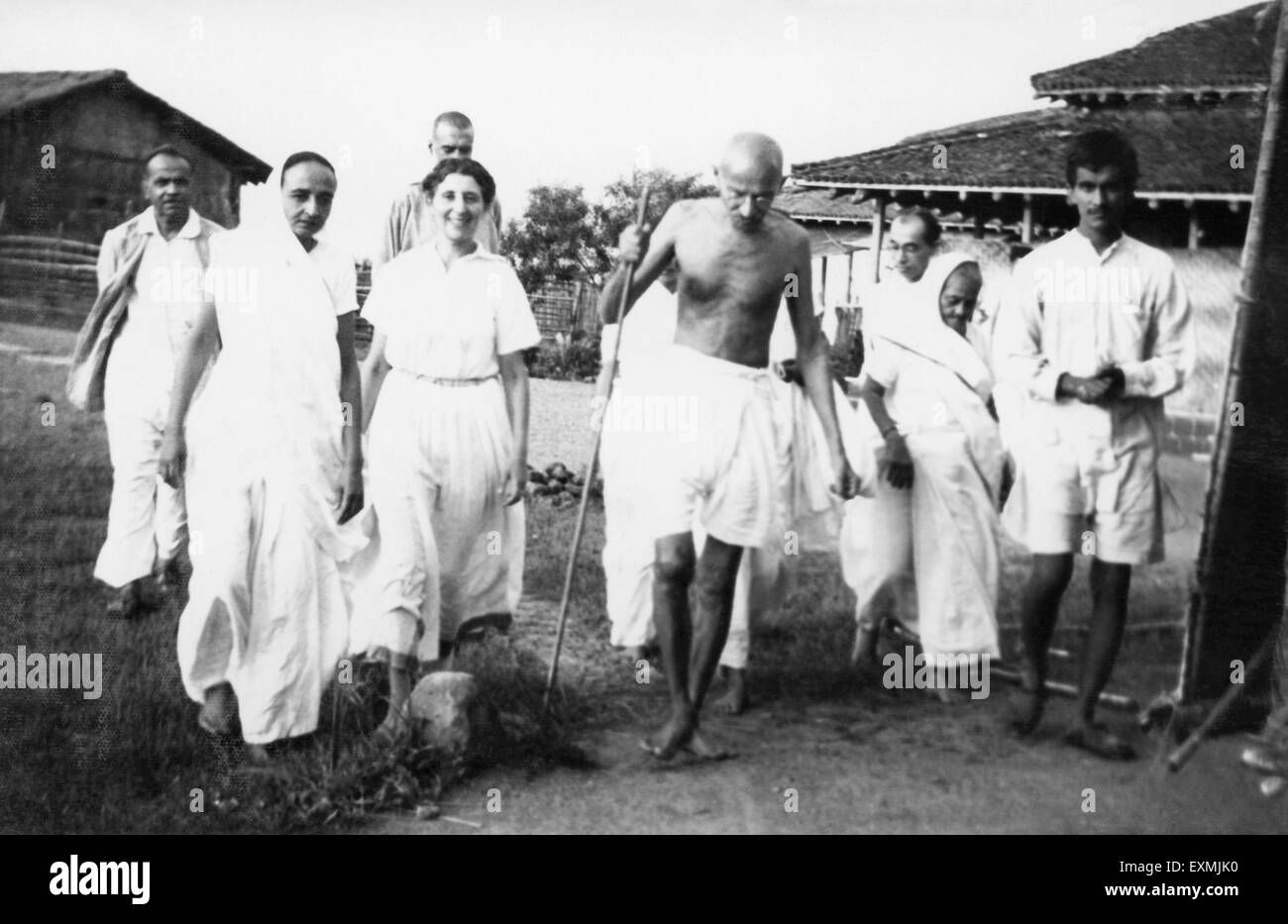 Balwant Singh presents a newborn four hours old calf to Mahatma Gandhi and others at Sevagram Ashram ; 1940 NO MR - Stock Image