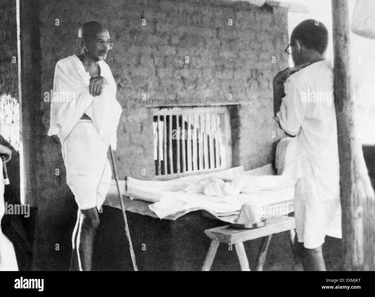 Mahatma Gandhi talking with J C Kumarappa at Sevagram Ashram ; 1940 NO MR - Stock Image