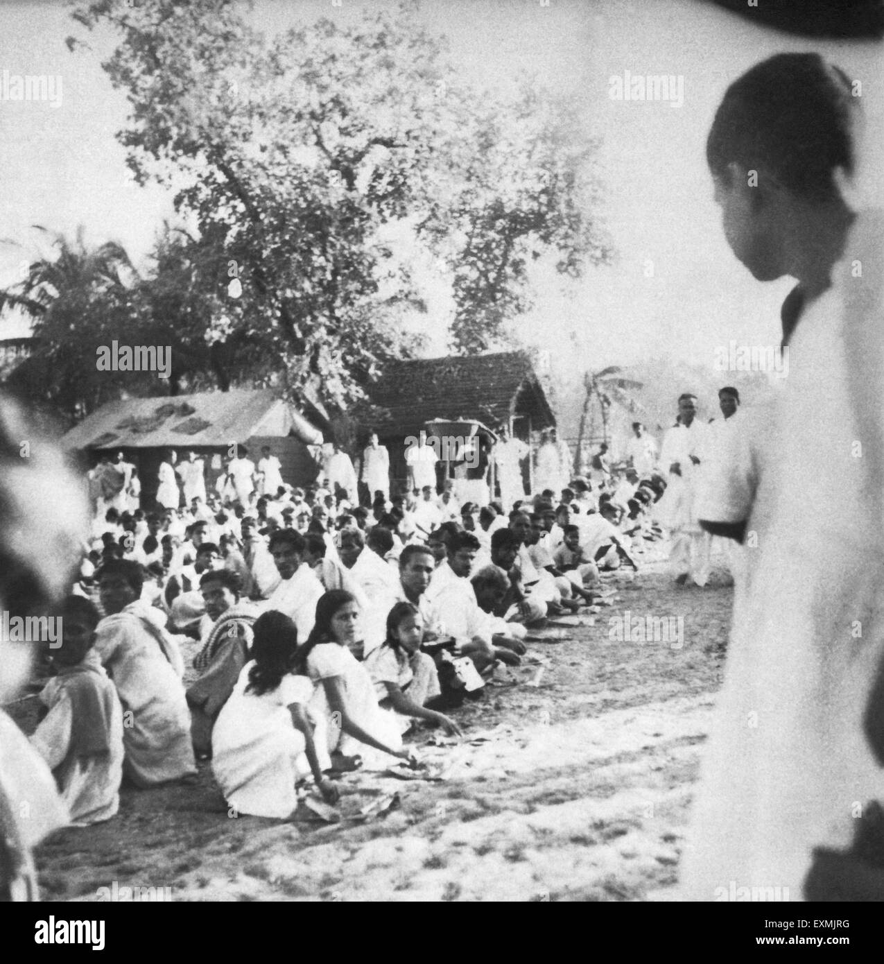 People waiting to meet Mahatma Gandhi after the riots between Hindus and Muslims in Chandipur ; Noakhali East Bengal - Stock Image