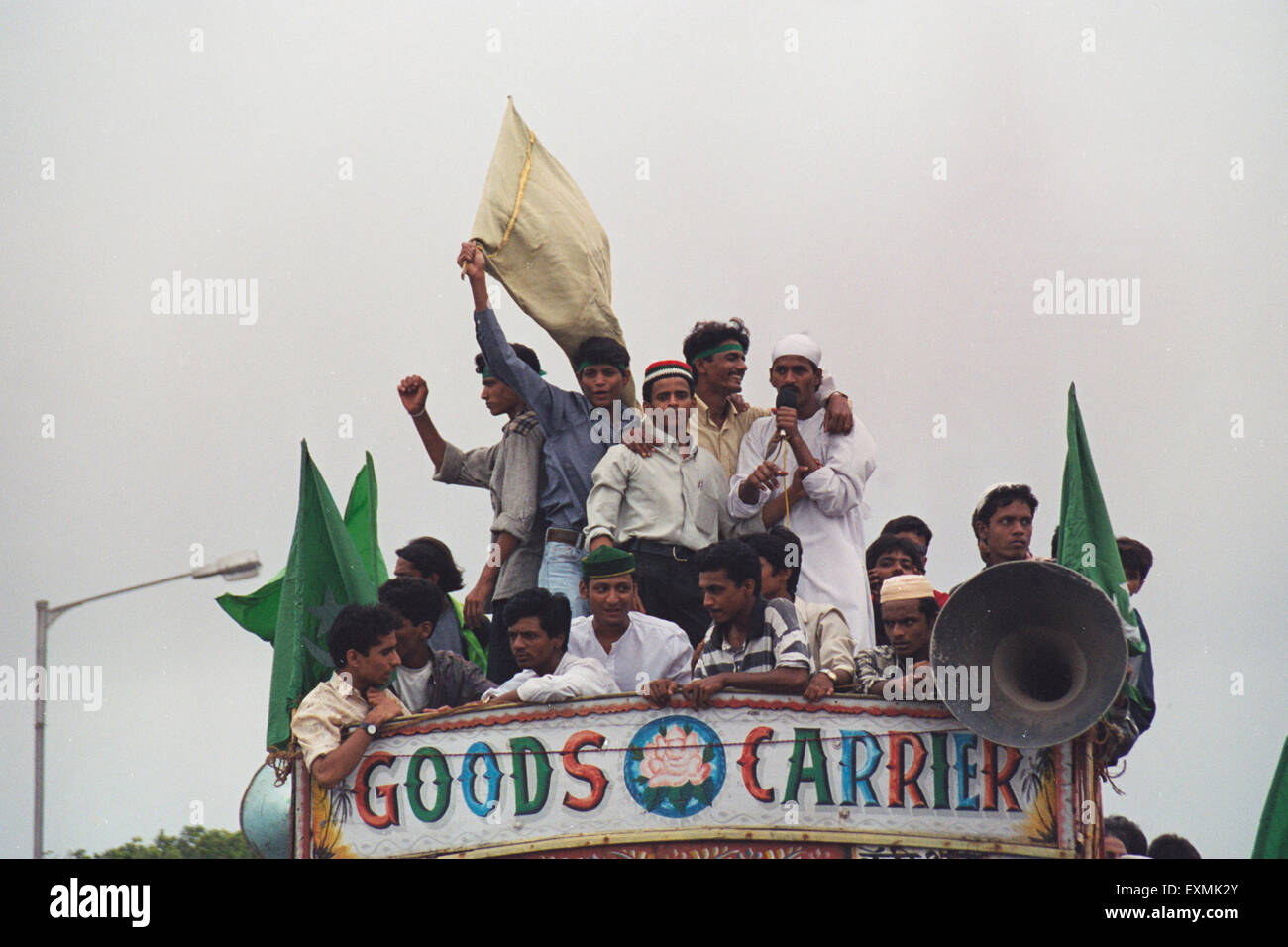 Demonstrators on top of truck mumbai india - Stock Image