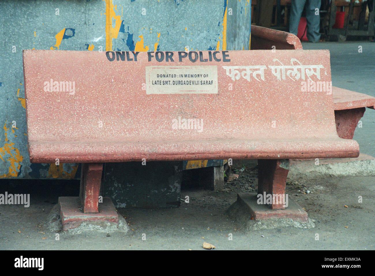 Only for police written on bench on street Bombay Mumbai Maharashtra India - Stock Image