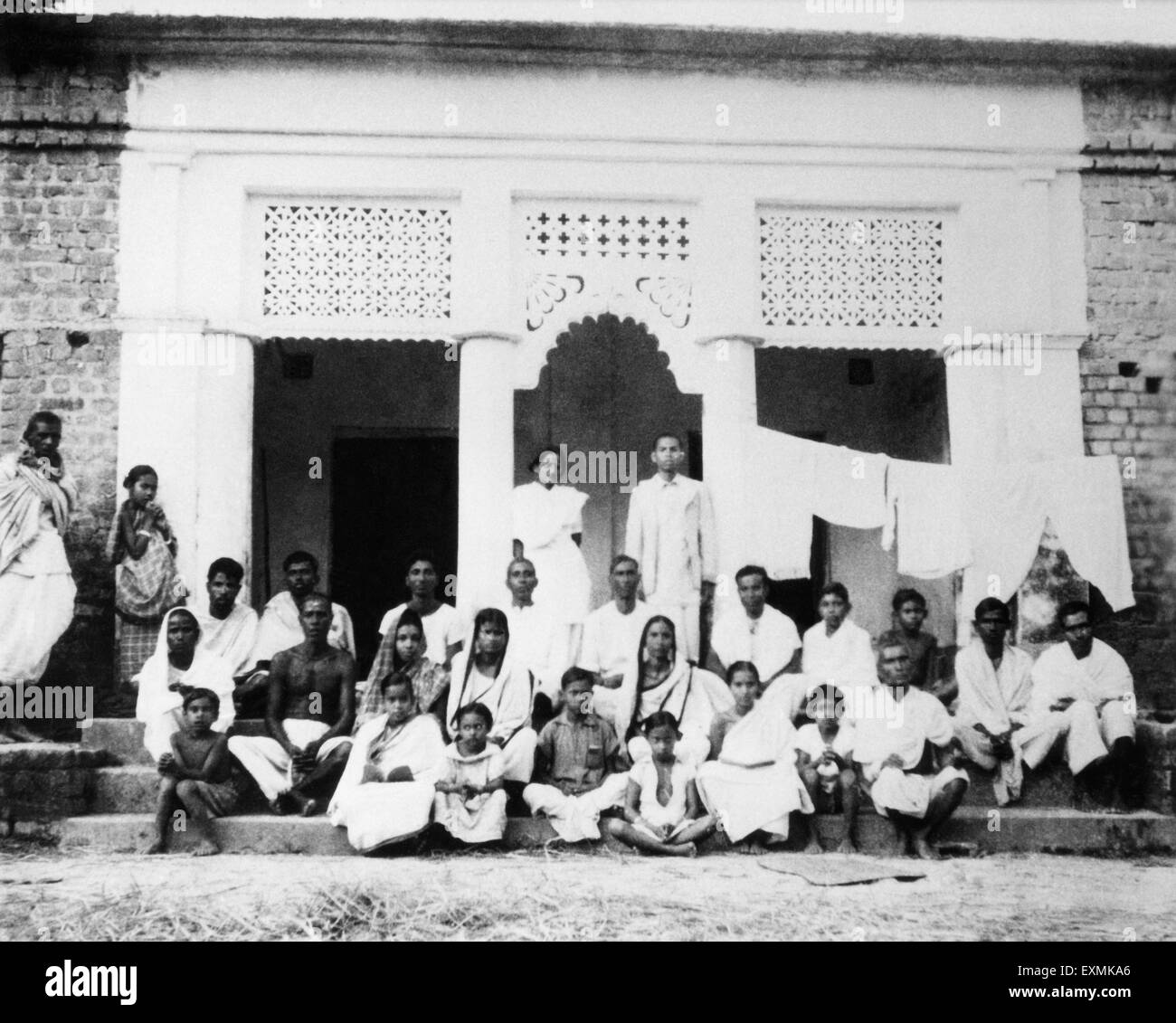 Amtus Salam and village people in the riot stricken area of Noakhali East Bengal ; November 1946 ; India NO MR - Stock Image