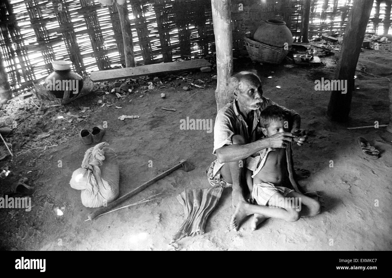 A fourth grade malnutrition child inside a hut in a village on the Maharashtra Gujarat border ; India - Stock Image