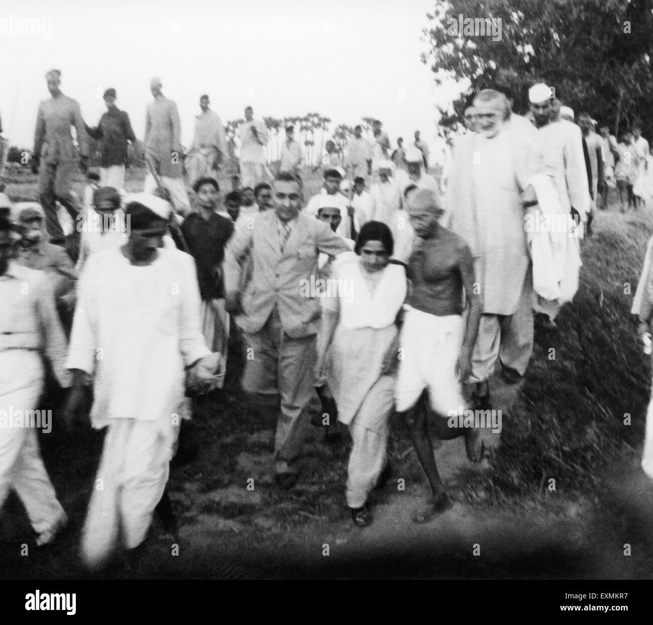 Mahatma Gandhi and others on his march through the riot stricken areas of Bihar ; 1947 ; Mridulabehn Sarabai - Stock Image
