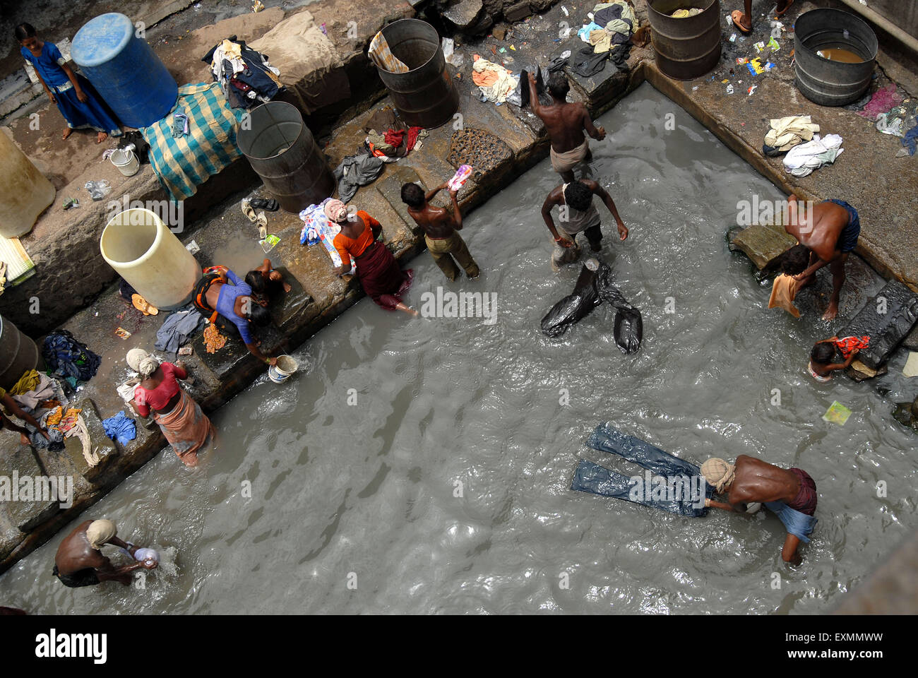 Washer men wash clothes in dirty waters at Dharavi in Bombay now Mumbai ; Maharashtra ; India - Stock Image