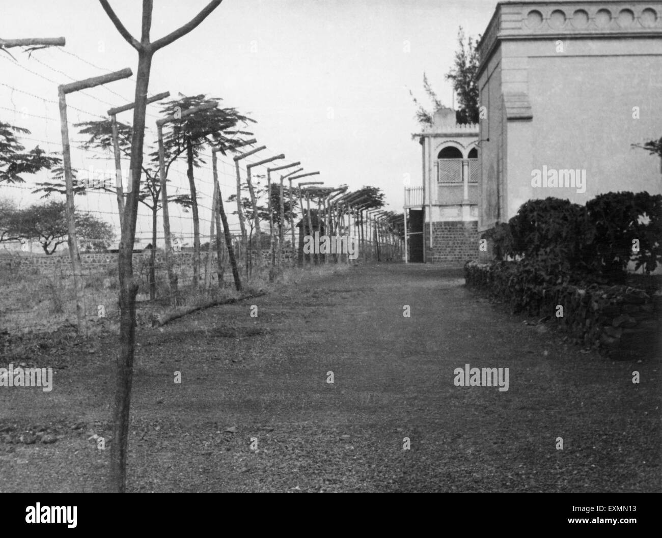 building with security barbed wire fence india 1950 Stock Photo ...