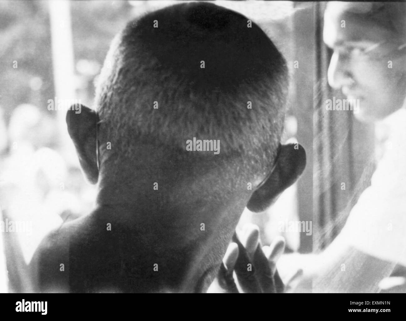 Mahatma Gandhi from rear during a train journey india 1945 - Stock Image